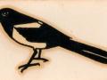 Burns Magpie 1980, ekster logo. Magpie is de bijnaam voor leden van de voetbalclub Newcastle United.