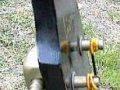Lion 104 Bass met 2 Luxtone pickups, zwarte headstock zijzicht.