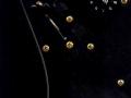 Detail zwarte 4 laags slagplaat Hank's Black Strat.