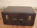 Jennings Univox Organ J7, crocodile skin suitcase met black plastic handle.