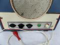 Framez Stereofonico buizenamp, bedieningspaneel. Vanaf links mixer, externe luidspreker, spanningscarroussel. Rechts Volume aan-uit.