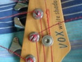 White Shadow  Bass,  4 snaren, 2 knops 1985, made in  Japan, headstock front.
