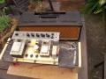 Vox AC10 Super Reverb Twin 1964, grey panel 4 inputs. Vibrato kanaal Amp, Speed, Volume control, Normal kanaal Volume en Tone control. Pill-voltage selector.