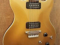 SDC-33 Solid Double Cutaway Goldtop 2010 Indonesie, Alu Max Connect bridge, Twin CoAxe pickups, body front.