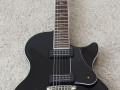 SSC 55 Solid Single Cutaway Black 2010 Korea, Alu Max Connect bridge, Twin CoAxe pickups, front.