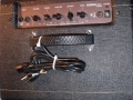 2001-2005 T25 Solid State Bass amp 25 watt. 10 inch speaker en horn. Made in Korea. red panel met tone en equalizer met 4 Tone Controls.